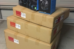 DXRacer PS200 and Logitech G920 in boxes